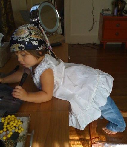 My daughter Misha playing at my old vanity.