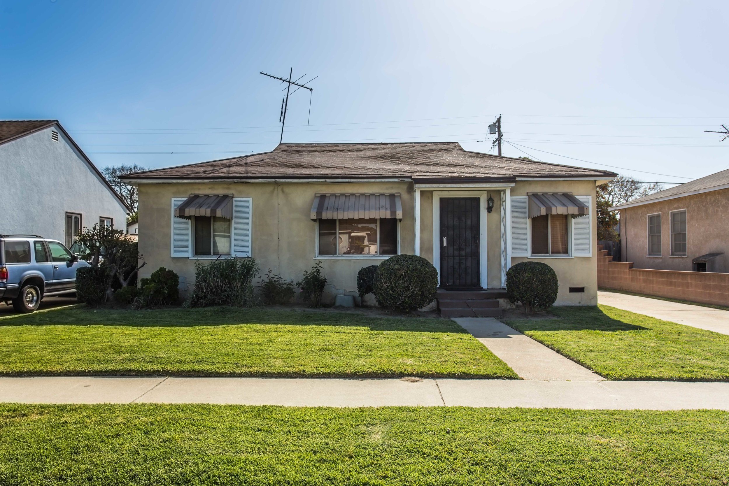 So much potential! This home has a great layout, original wood floors, large kitchen, a spacious backyard with fruit trees and a block wall fence, and a detached two car garage with a long driveway – plenty of parking! Ready for a new owner to make their own.