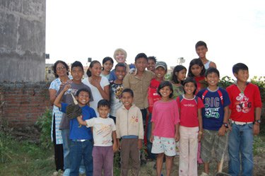 Cathy and helpers with some of the children.