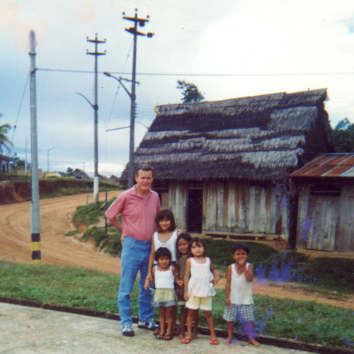Leon with a Peruvian Family in front of their home in Iquotos, Peru.