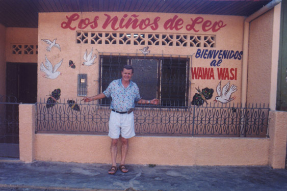 Leon Jones standing in front of Los Niños de Leo in Iquitos, Peru.
