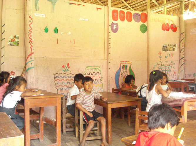 Typical rural class room with thatched roof and open walls.