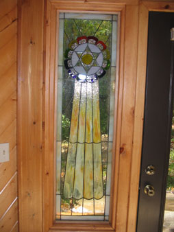 Stained Glass Side Panels to the Entrance Door to the Chapel replicating the Sacred Symbol of Mu (Colonel James Churchward).