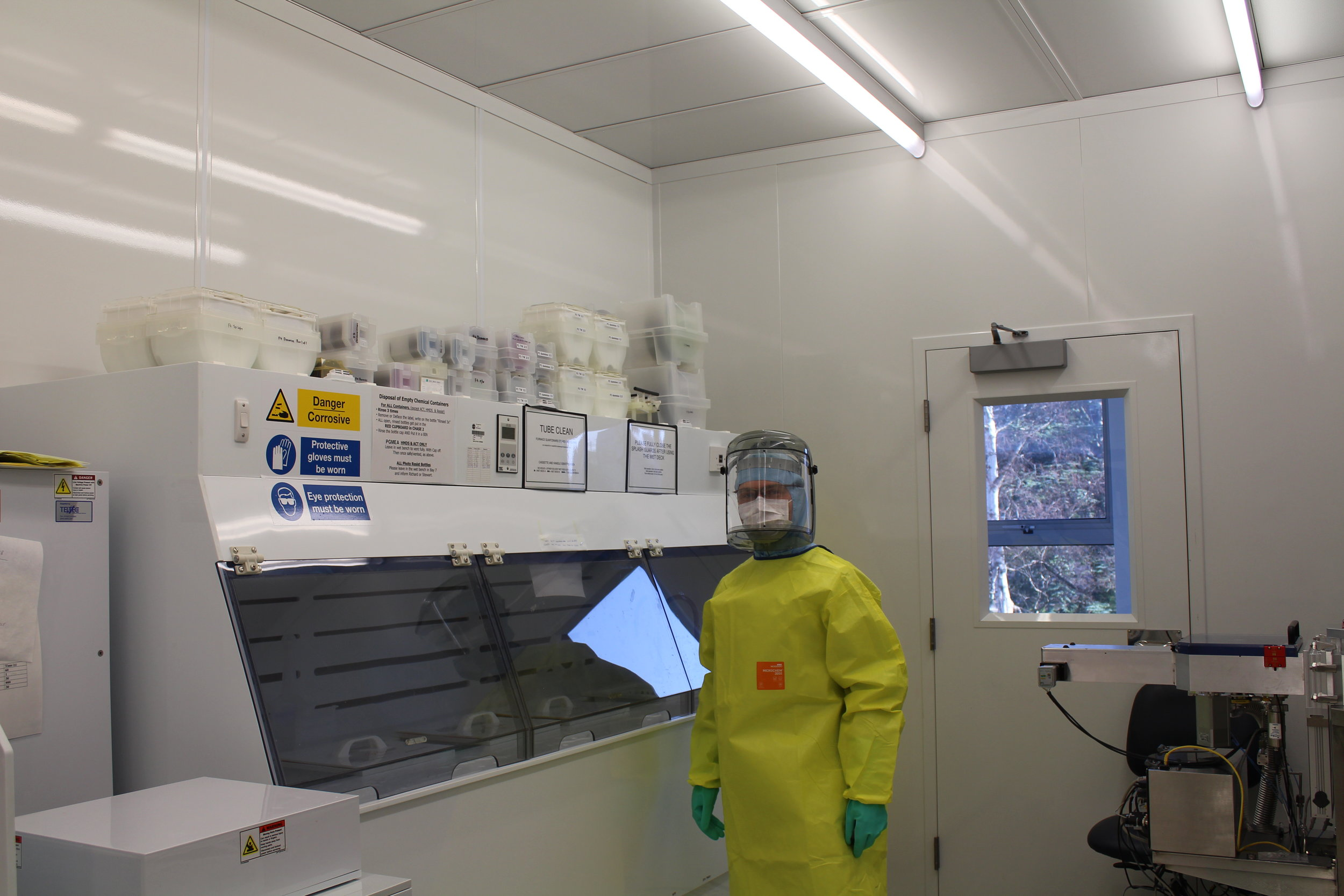 Piotr in protective clothing to undertake wet chemical etching