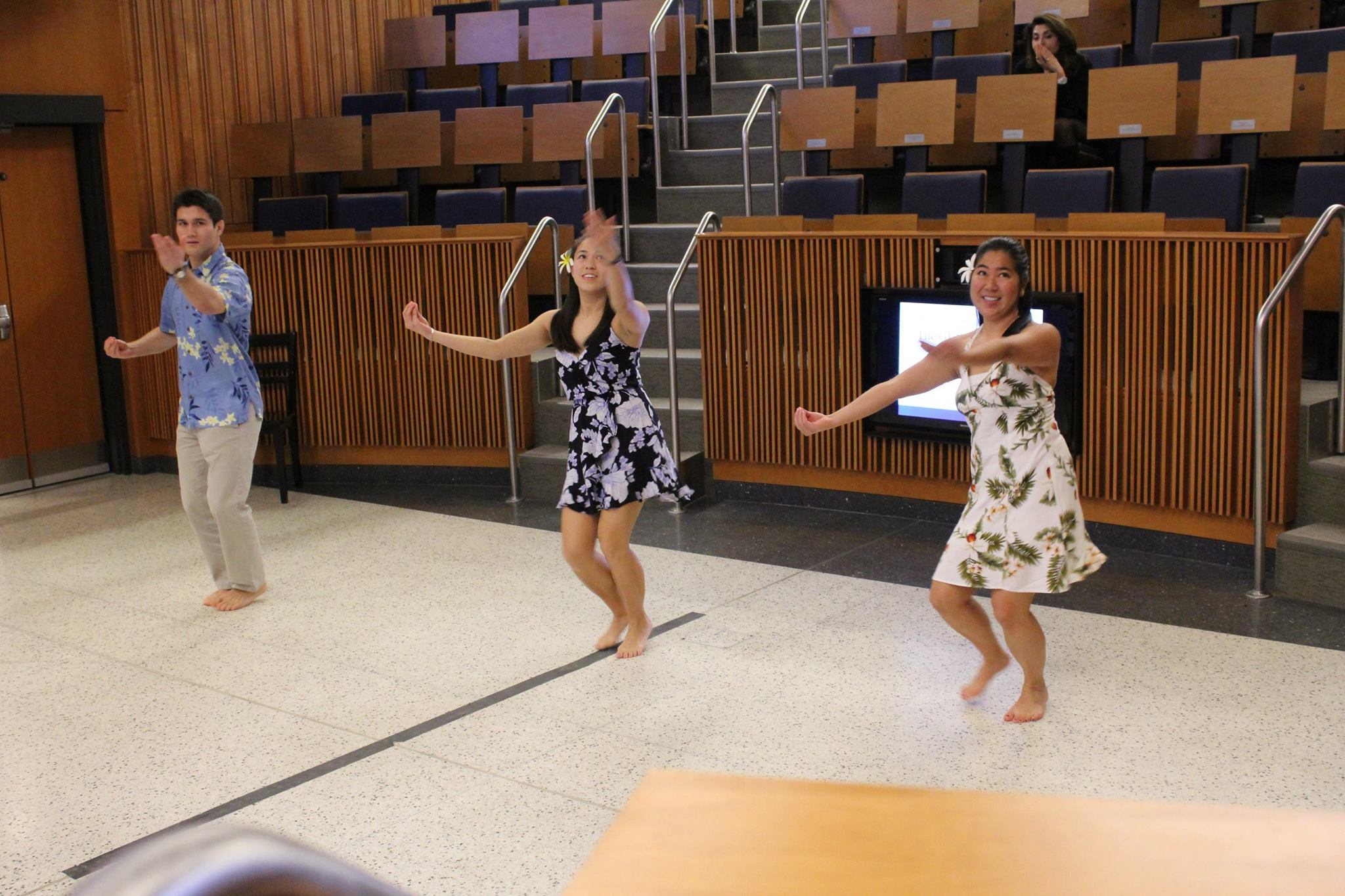 Brett Will (M2021), Kellie Wo (M2021), and Callie Takahashi (M2020) perform hula to He Mele No Lilo.