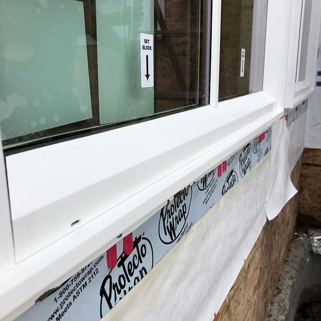 All windows will leak. Plan for it. Pitched rough sill, sill pan, horseshoe shims below the frame and between the sill face  and bottom nailing flange. NEVER apply sealant along the bottom nailing flange. When that window leaks (because it will happen) water will drain from the assembly right into the rainscreen, down the water resistive barrier and out of the wall. No wall assembly component will be the least bit upset by the whole ordeal! Water will happen, especially in coastal BC — promote the drainage and drying afterwards and don't worry about it!