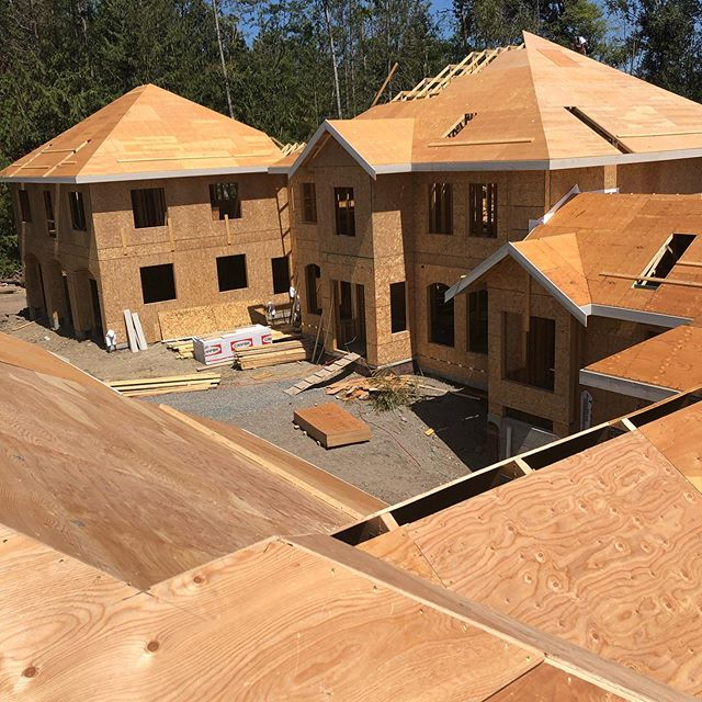 That's a lot of house over there, and there's a lot of house under my feet. We are almost ready for roofing on one of our Langley Custom Homes being framed by @gouletdevelopments . You can see the plywood held back at the peaks for ridge venting to minimize visible vents and maximize attic ventilation. Hip roofs don't allow for adequate venting through ridge venting alone, but we will run the calculations and then make up the required ventilation with typical vents. #norconbuilt @mariejoydesign