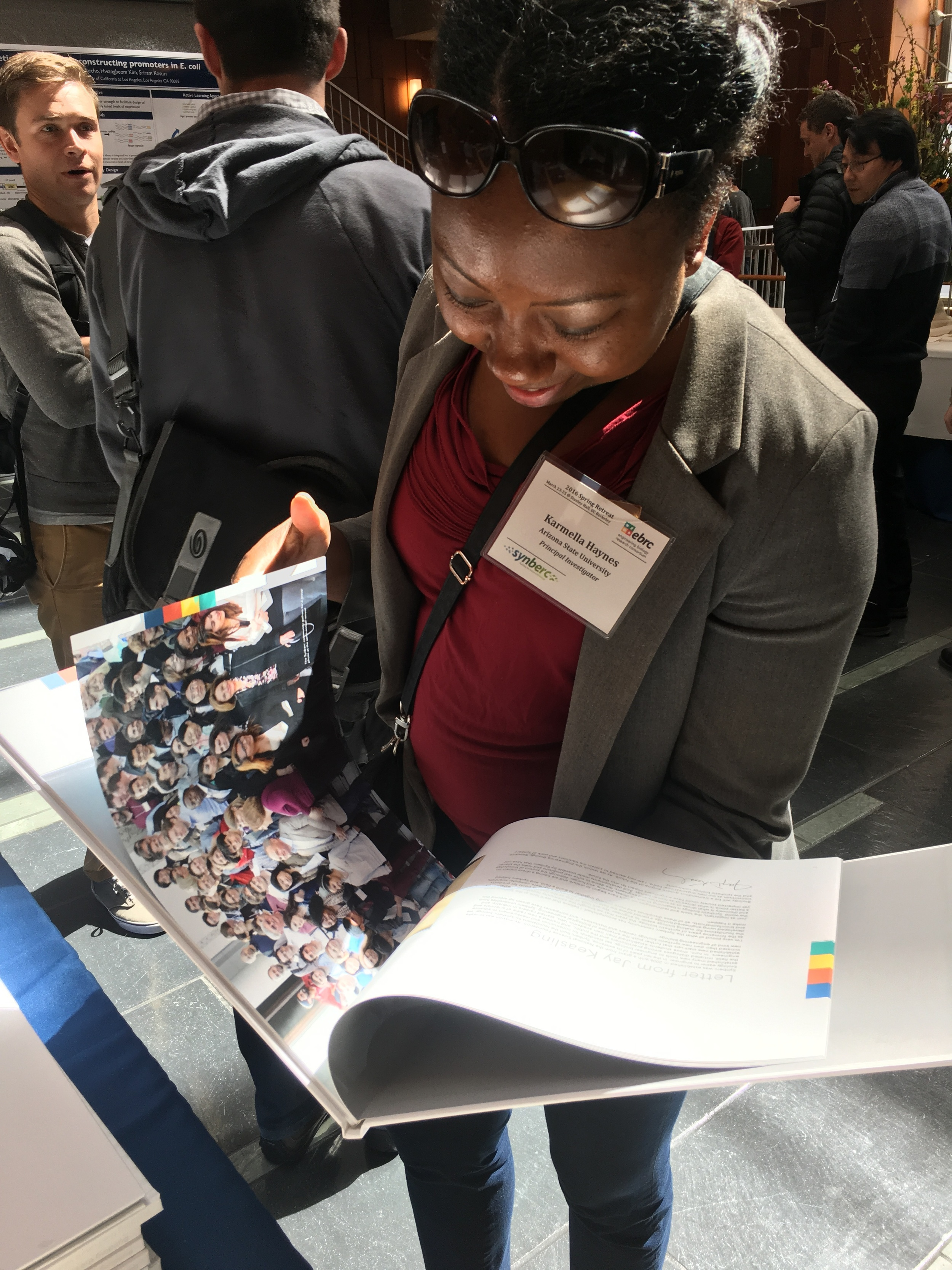 EBRC Board member and researcher ( ARIZONA STATE) Karmella Haynes thumbs through the pages of the book