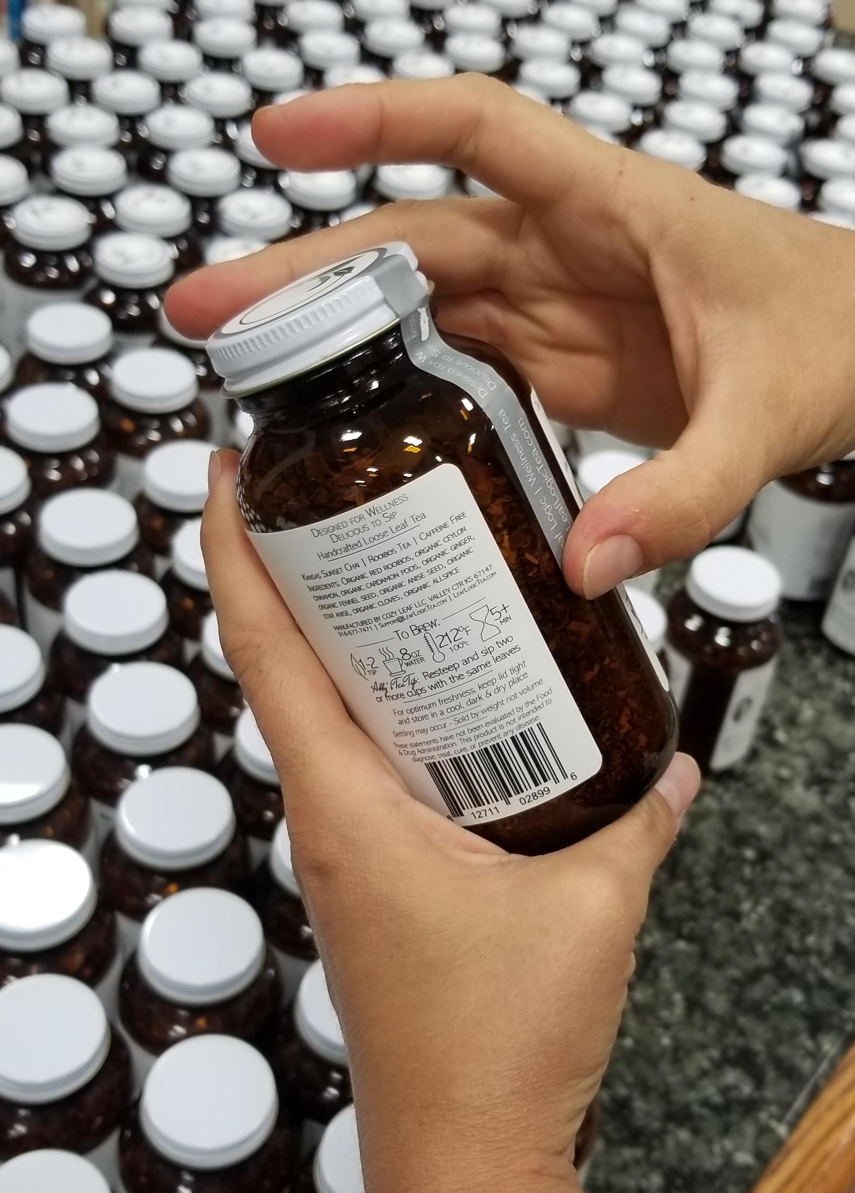Leaf Logic Jar Packaging by hand.jpg
