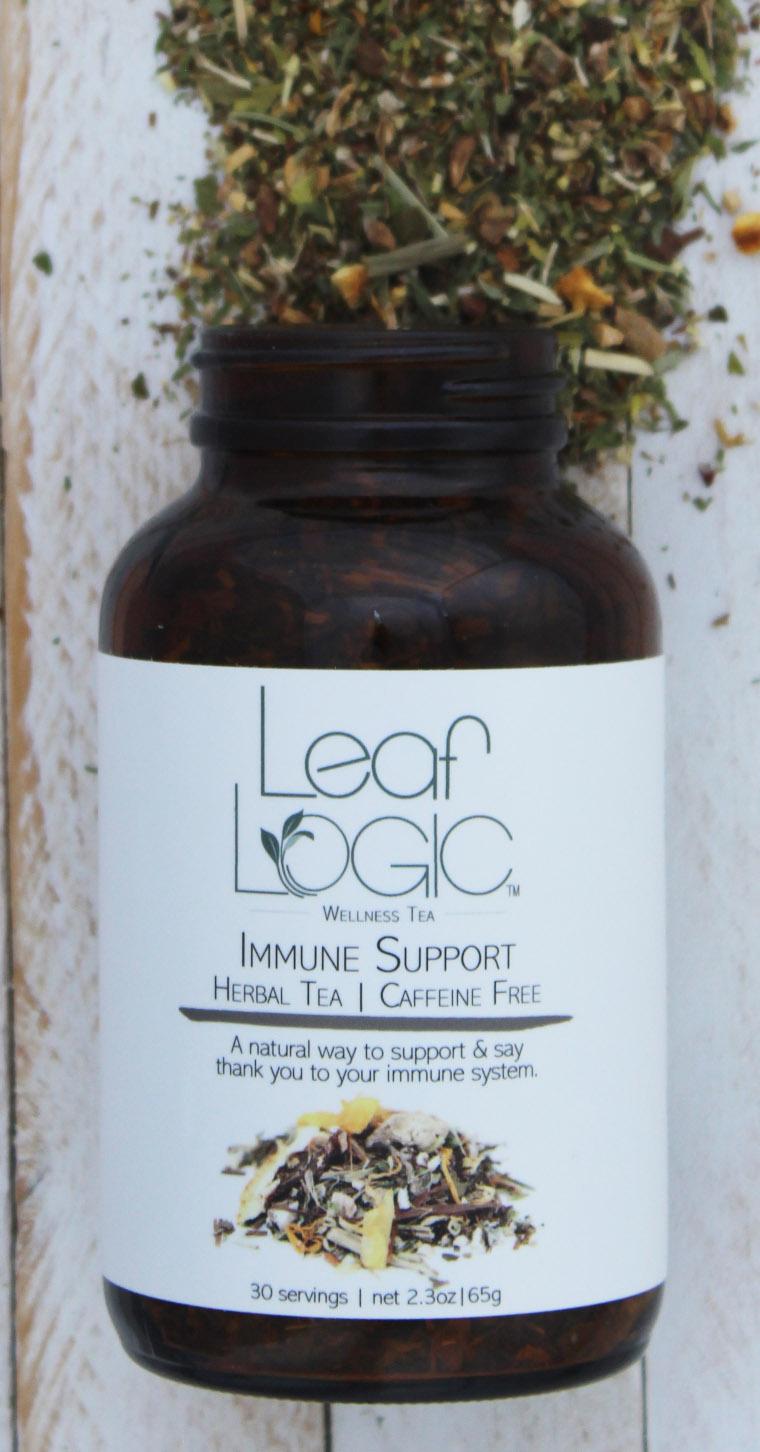 Immune Support Amber Bottle Open white wood cropped.jpg
