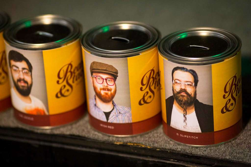 Donation cans for bearded - and competing - folk sit on display at the kickoff of the fifth annual Beard and Stache Fest on Sunday, Feb. 24, 2013, at Hilliard's Beer in Seattle, Wash. The night's events kicked off a month-long competition featuring over 100 furry-faced men. All donations benefited foster children in King County.   Photo: JORDAN STEAD