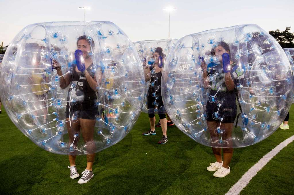 """Players struggle to gain access to the center of their bouncy, blue orbs during Seattle's first """"Bubble Futbol"""" - or soccer - tournament Sunday, September 7, 2014, at Cal Anderson Park in Capitol Hill in Seattle, Washington. The unlikely sport originated in Europe and is quickly sweeping the U.S., with a recent spotlight on The Tonight Show with Jimmy Fallon.The event was put on by Seattle-local nonprofit """"The World is Fun"""" as a celebration of the organization's fifth anniversary.   Photo: JORDAN STEAD, SEATTLEPI.COM"""