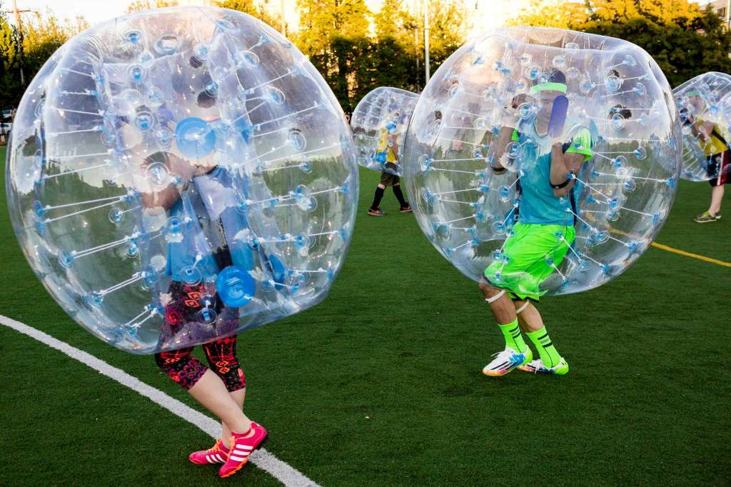 """Before the first match, players tested out the """"crash-ability"""" of their bouncy, blue orbs during Seattle's first """"Bubble Futbol"""" - or soccer - tournament Sunday, September 7, 2014, at Cal Anderson Park in Capitol Hill in Seattle, Washington. The unlikely sport originated in Europe and is quickly sweeping the U.S., with a recent spotlight on The Tonight Show with Jimmy Fallon.The event was put on by Seattle-local nonprofit """"The World is Fun"""" as a celebration of the organization's fifth anniversary.   Photo: JORDAN STEAD, SEATTLEPI.COM"""