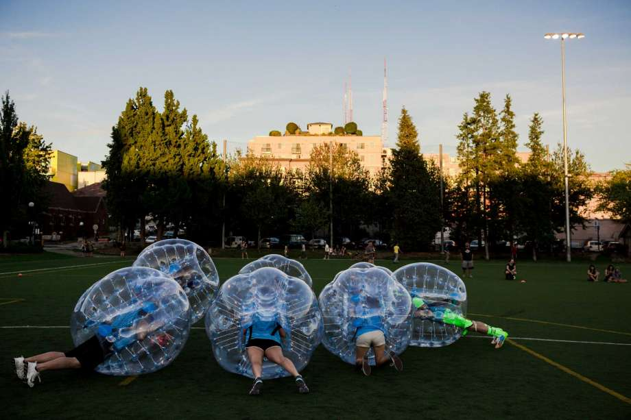 """Encased in bouncy, blue orbs, teams huddled up as best their rotund shape allowed them before a match at Seattle's first """"Bubble Futbol"""" - or soccer - tournament Sunday, September 7, 2014, at Cal Anderson Park in Capitol Hill in Seattle, Washington. The unlikely sport originated in Europe and is quickly sweeping the U.S., with a recent spotlight on The Tonight Show with Jimmy Fallon.The event was put on by Seattle-local nonprofit """"The World is Fun"""" as a celebration of the organization's fifth anniversary.   Photo: JORDAN STEAD, SEATTLEPI.COM"""