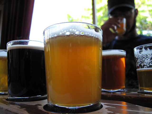 """"""" Beer tasting at Elysian Brewery ,"""" by Narisa Spaulding. Licensed under Attribution-NonCommercial-NoDerivs 2.0 Generic (CC BY-NC-ND 2.0)."""