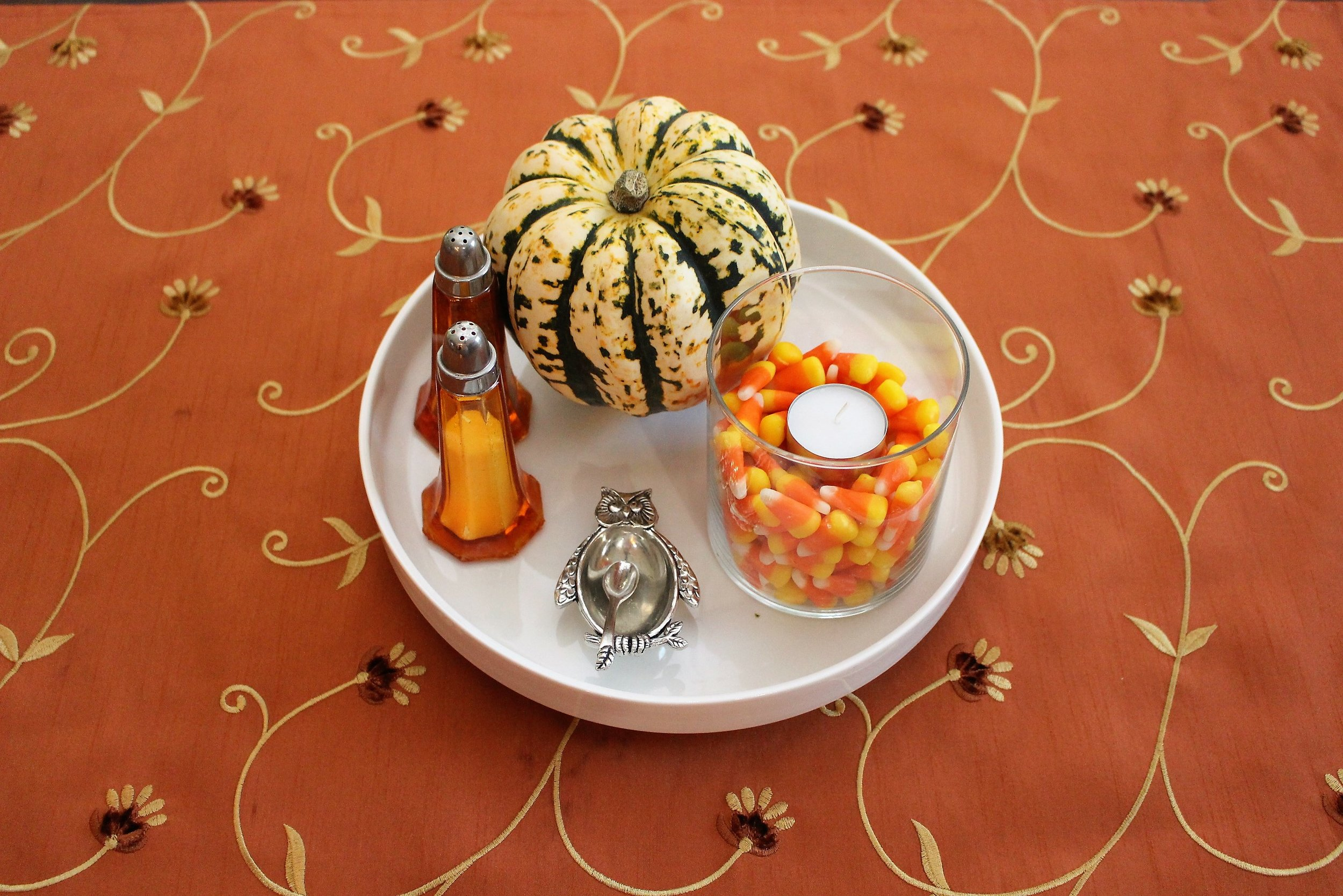 This is how I have been using a candle jar for fall.  This little plate sits on the counter or on the dinner table.