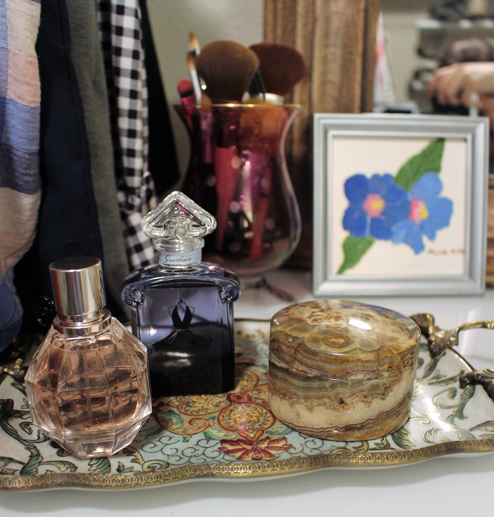 Perfume bottles make the perfect closet decor accessories!  I keep the ones I typically wear on my dresser and others hanging on the wall.