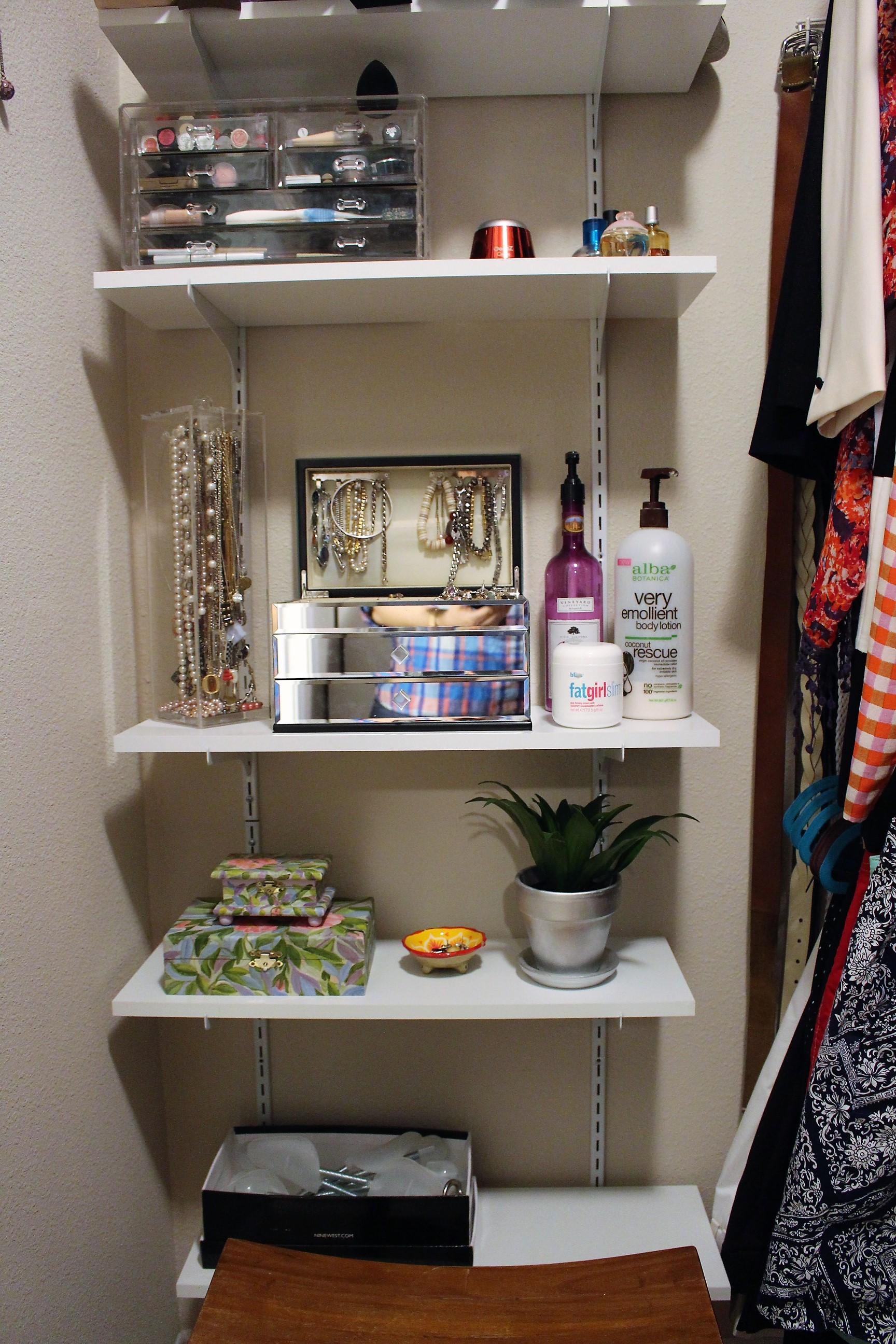On the opposite side of the closet, I installed shelving to help me store some of my jewlery and makeup.