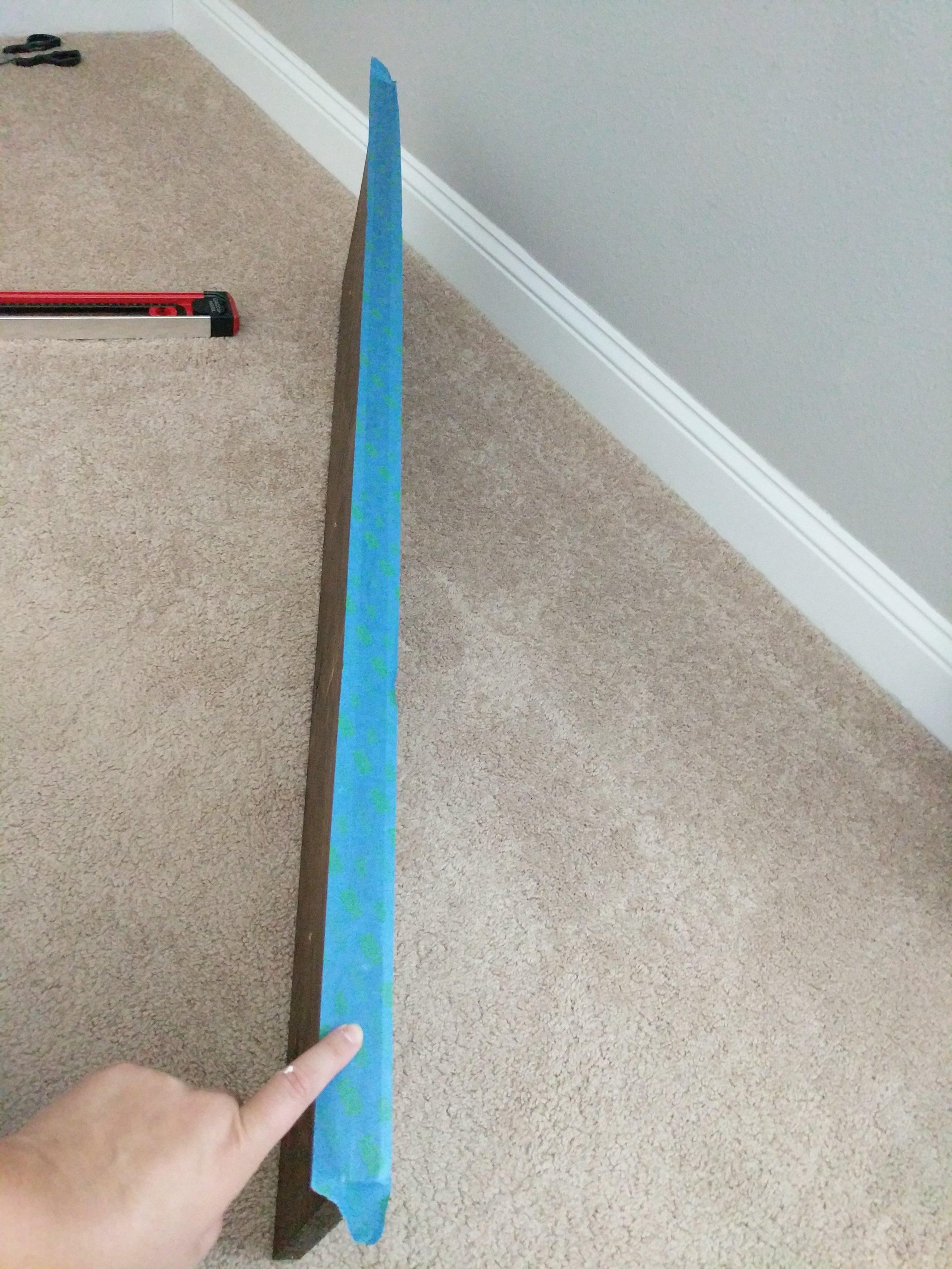 1. Add painters tape to shelf