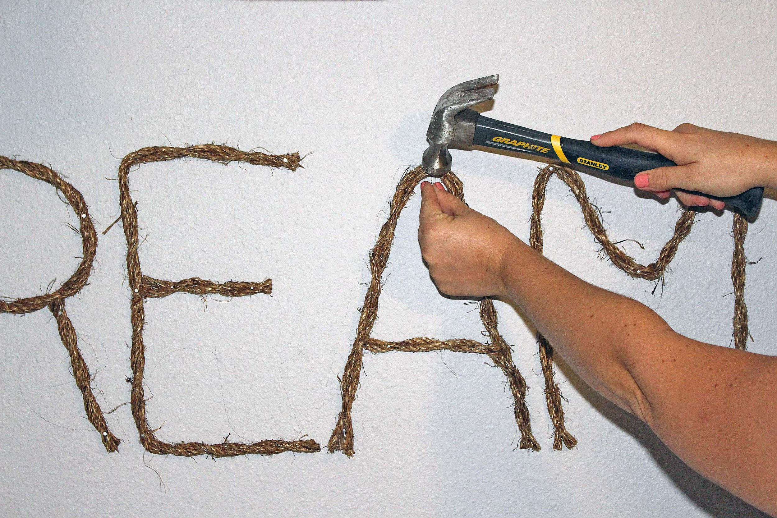 Creating a DIY rope sign for your wall