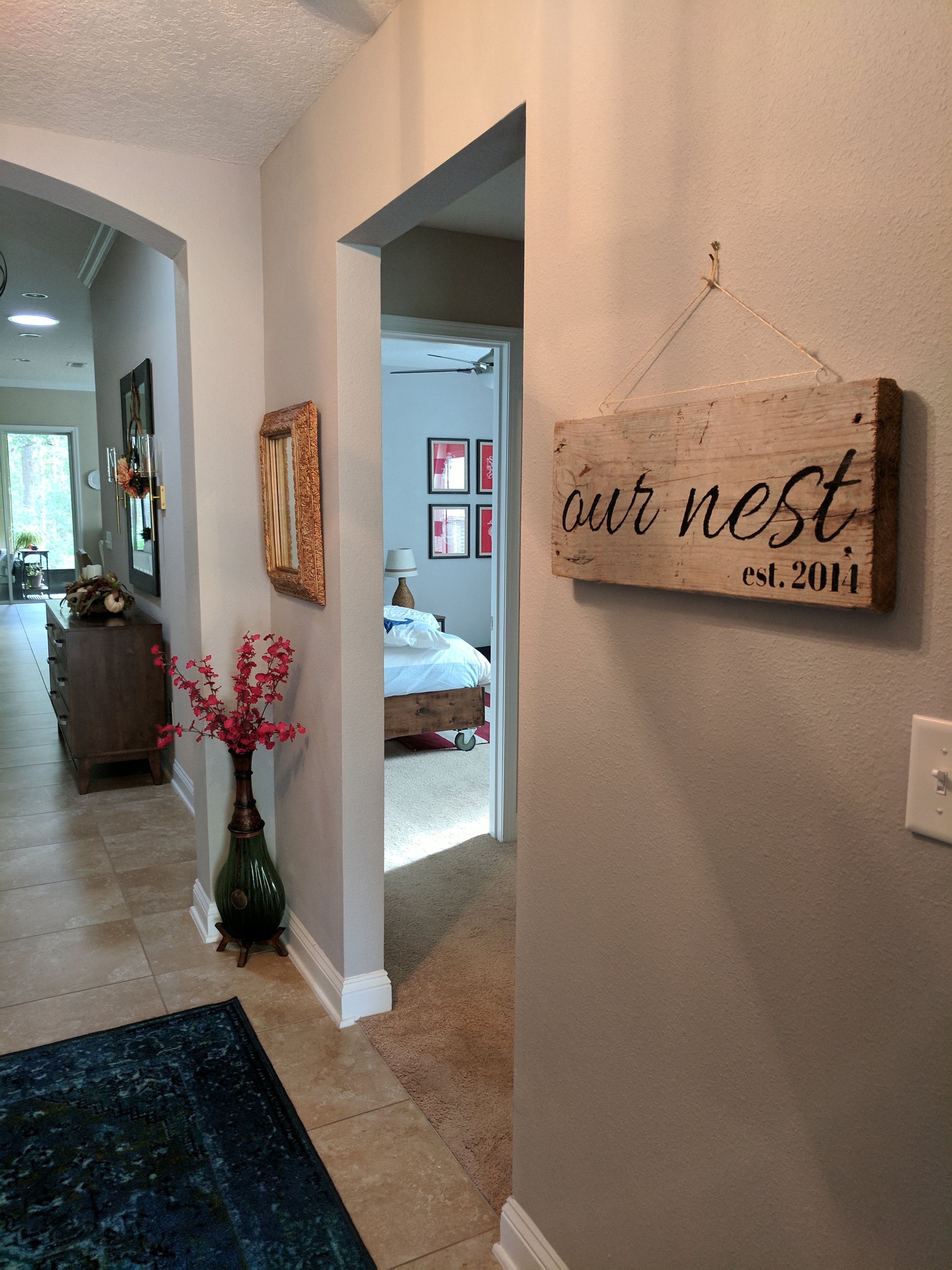 hand lettered 'our nest' sign
