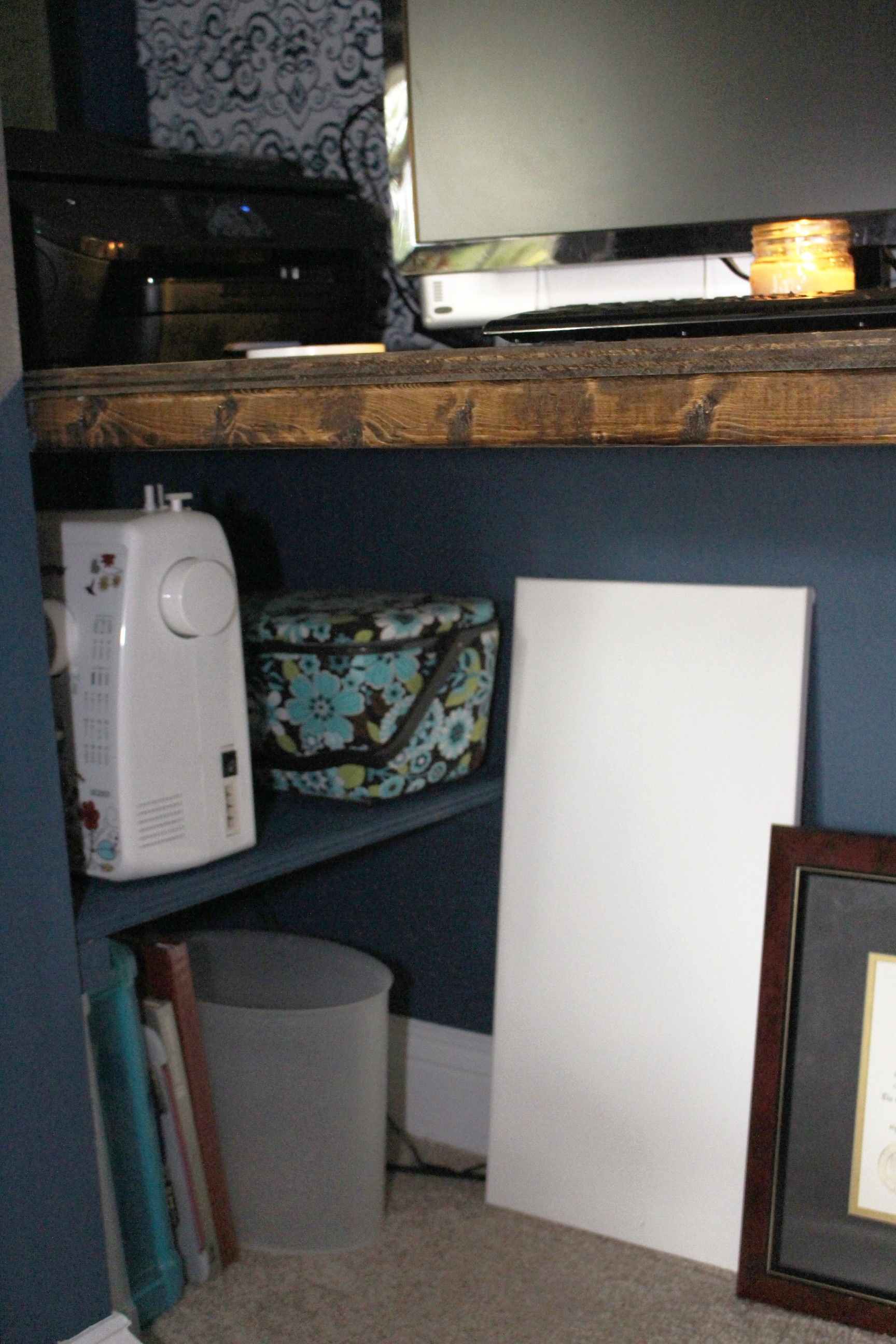 Disguising shelf by painting it the same color as wall
