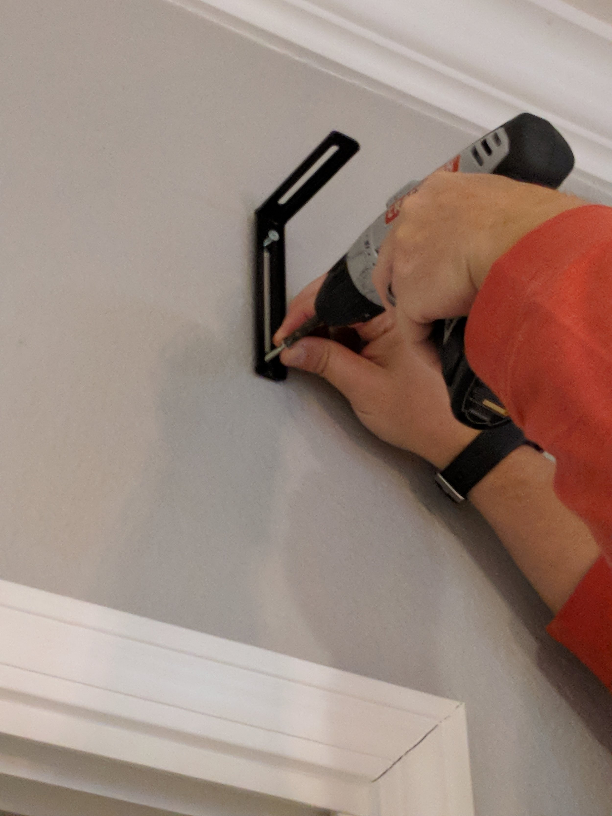 Attaching the wall bracket to the wall.