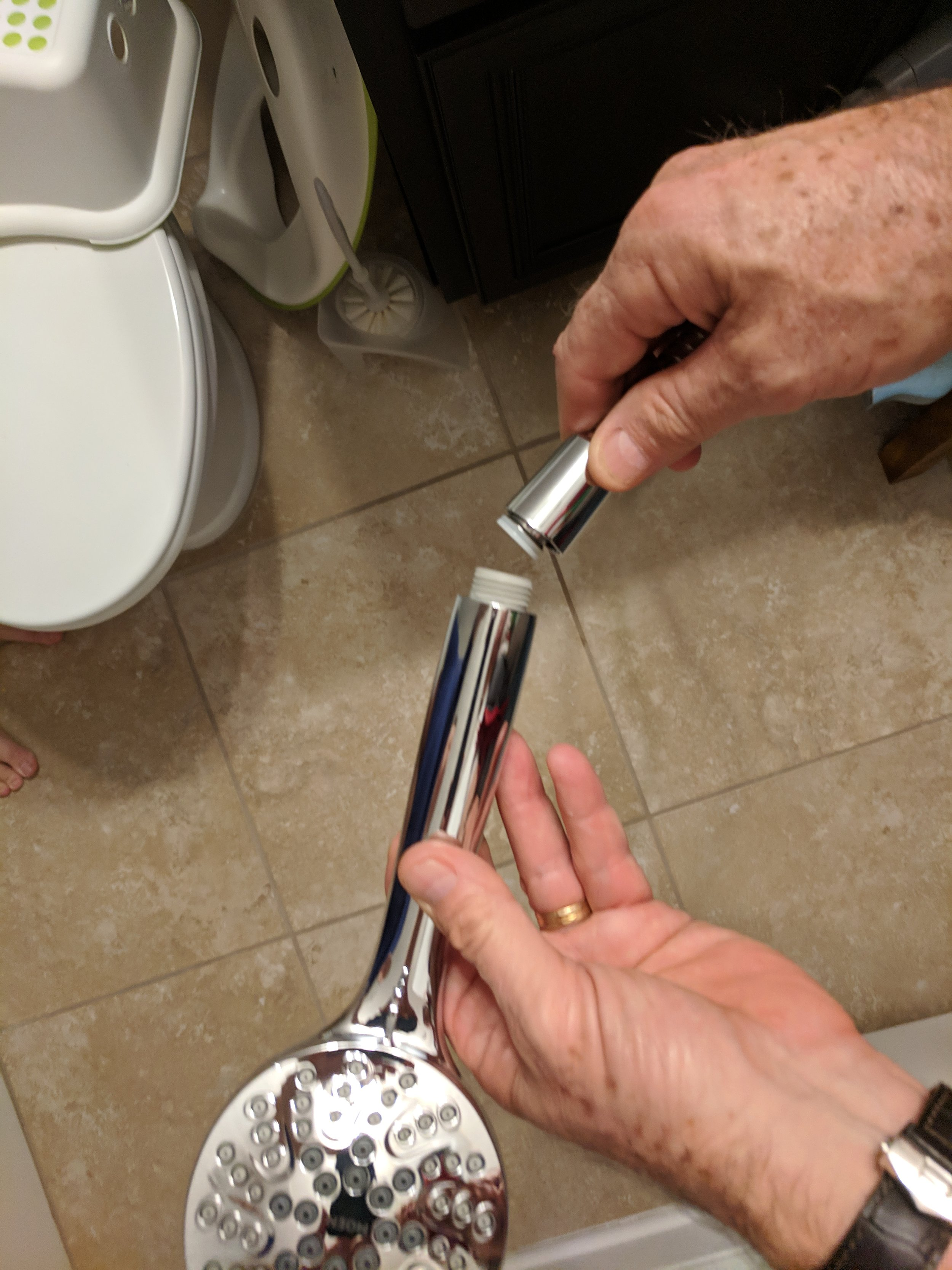 Connect the hose to shower head.