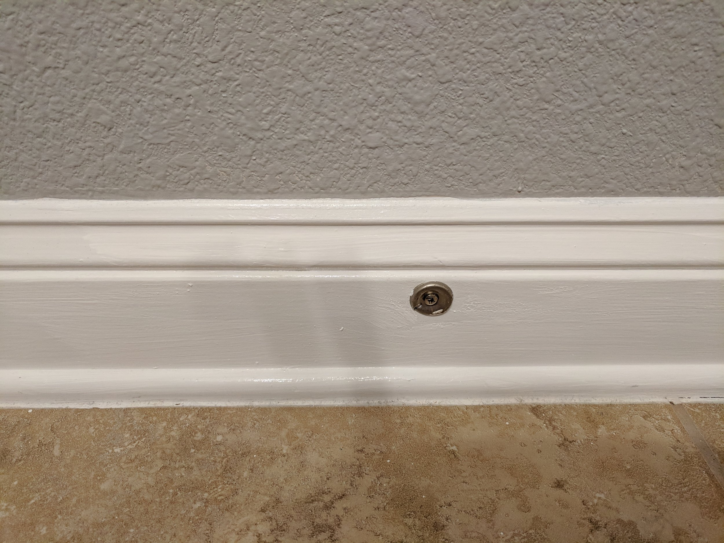 Cleaning and painting the baseboards made a huge difference in updating the bathroom.
