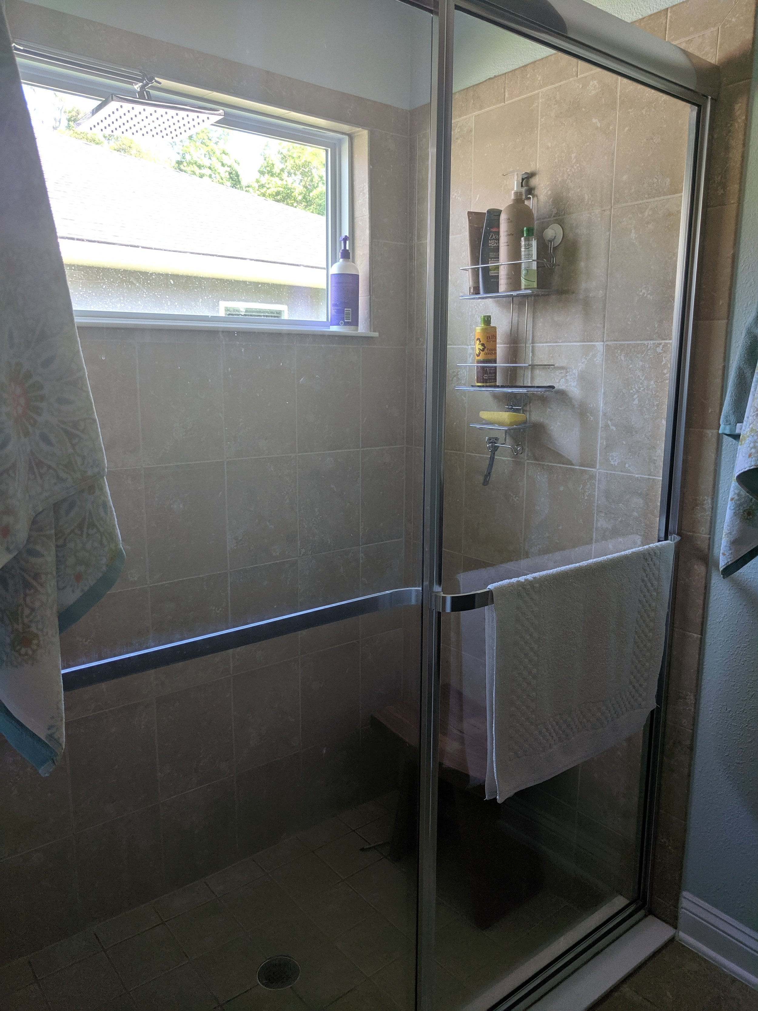 BEFORE: Saying goodbye to these shower doors!