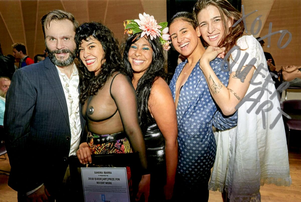 Xandra Ibarra (2nd left), winner of the 2018 Queer|Art|Prize for Recent Work, with friend Vivian Crockett (center), and QA staff Travis Chamberlain (left), KT Pe Benito (2nd right), and Rio Sofia (right) at the Queer|Art Annual Party, image by Eric McNatt