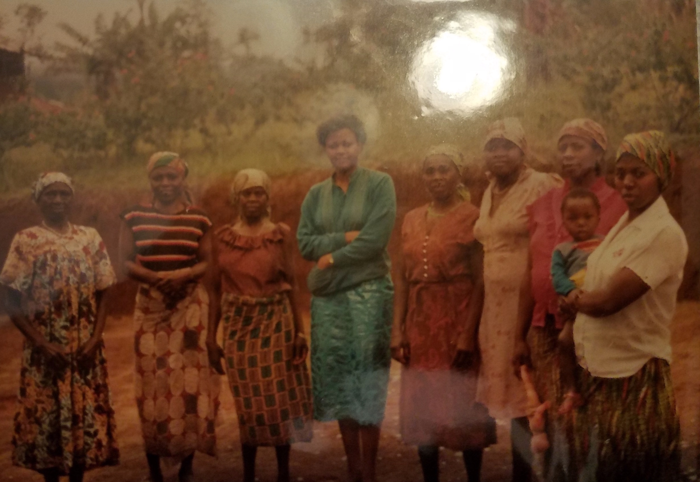 My aunt (in green) with the family of her late husband. She wears a modern skirt as the women of the village wear wrappas.