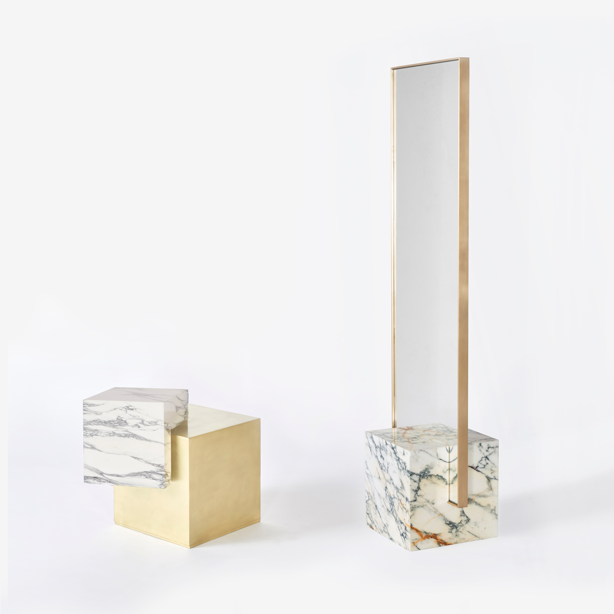 Askew Side Table in Brass with Statuary Marble, alongside our Coexist Standing Mirror