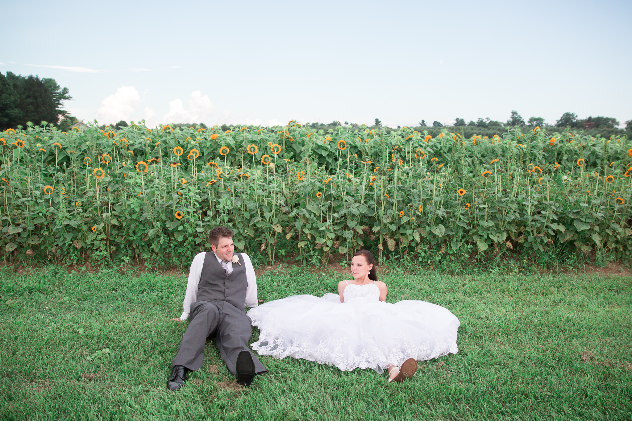 Ok, so I know this isn't a posed photo and they have soooo many awesome photos from the day! But I love how when Christina wanted a break, she had no problem just plopping down where she was....right in front of all the sunflowers :) Of course they still look awesome just chillaxin.