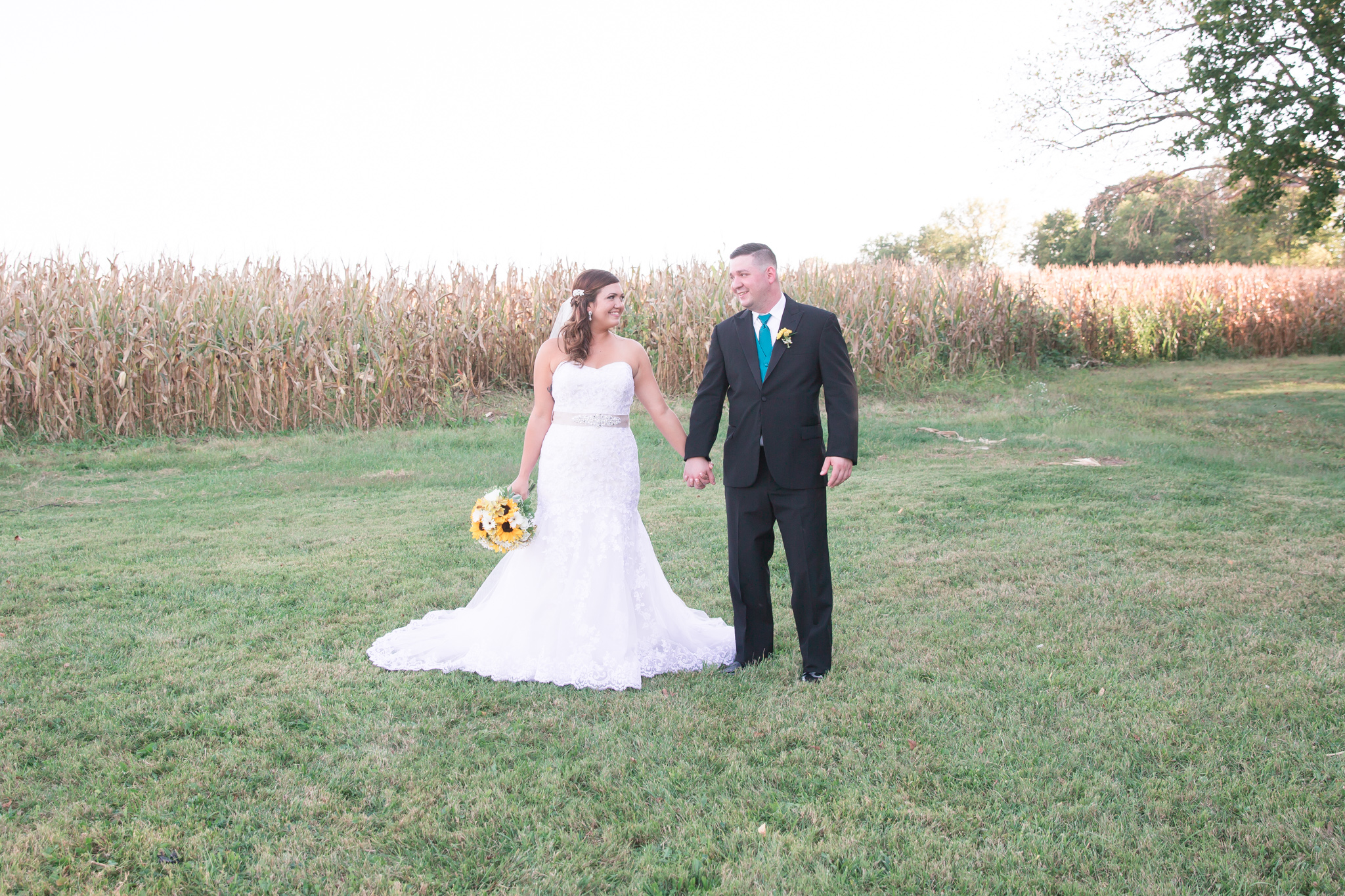 Oh photographing by a cornfield. I powered through having two bugs in my eyes while photographing Helen and Dan. This pic is super cute and despite the bugginess, I loved the location!