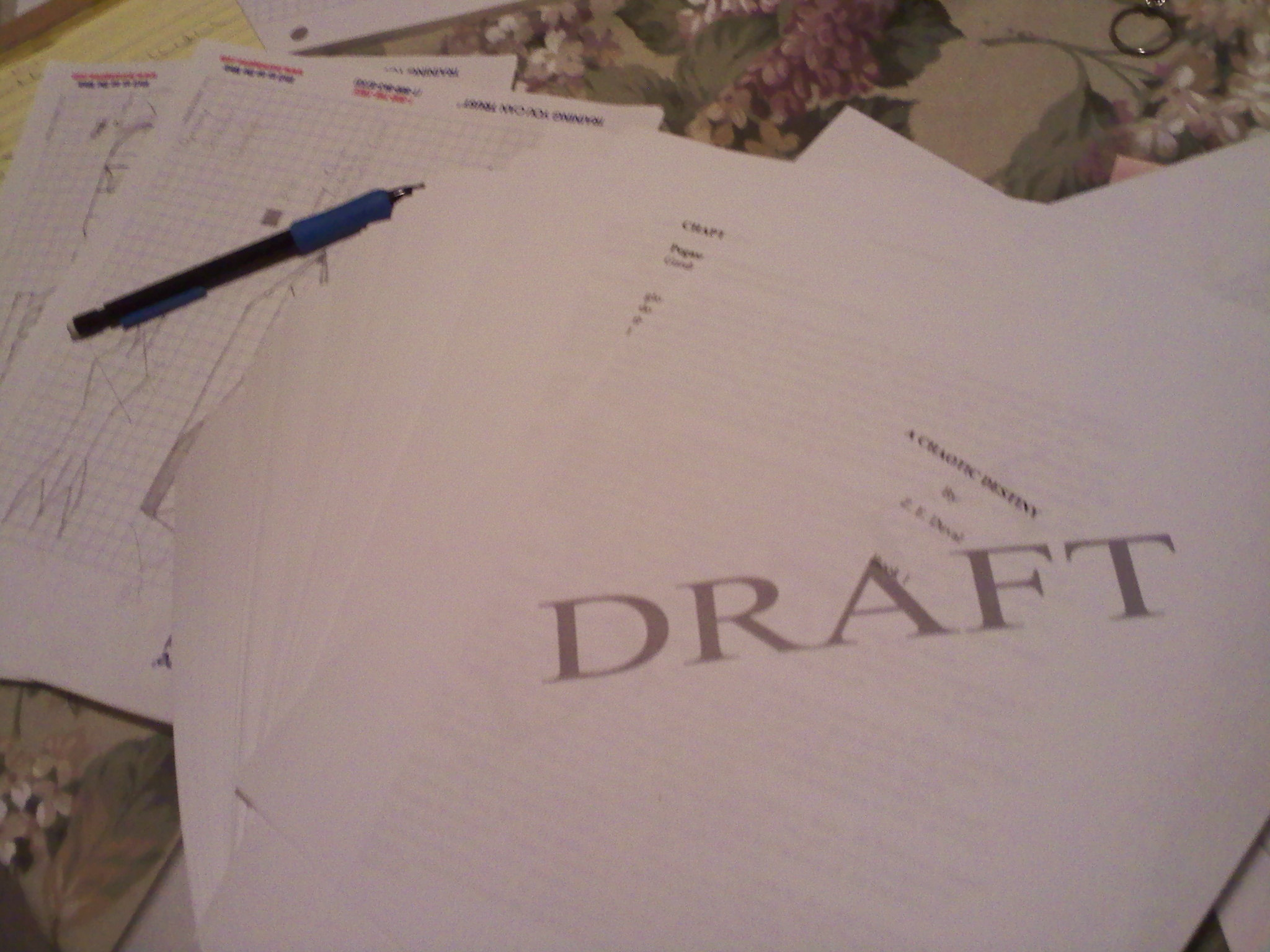 """The first printed draft of """"A Chaotic Destiny"""" circa Jan 2013. Note terrified graph paper in the background."""