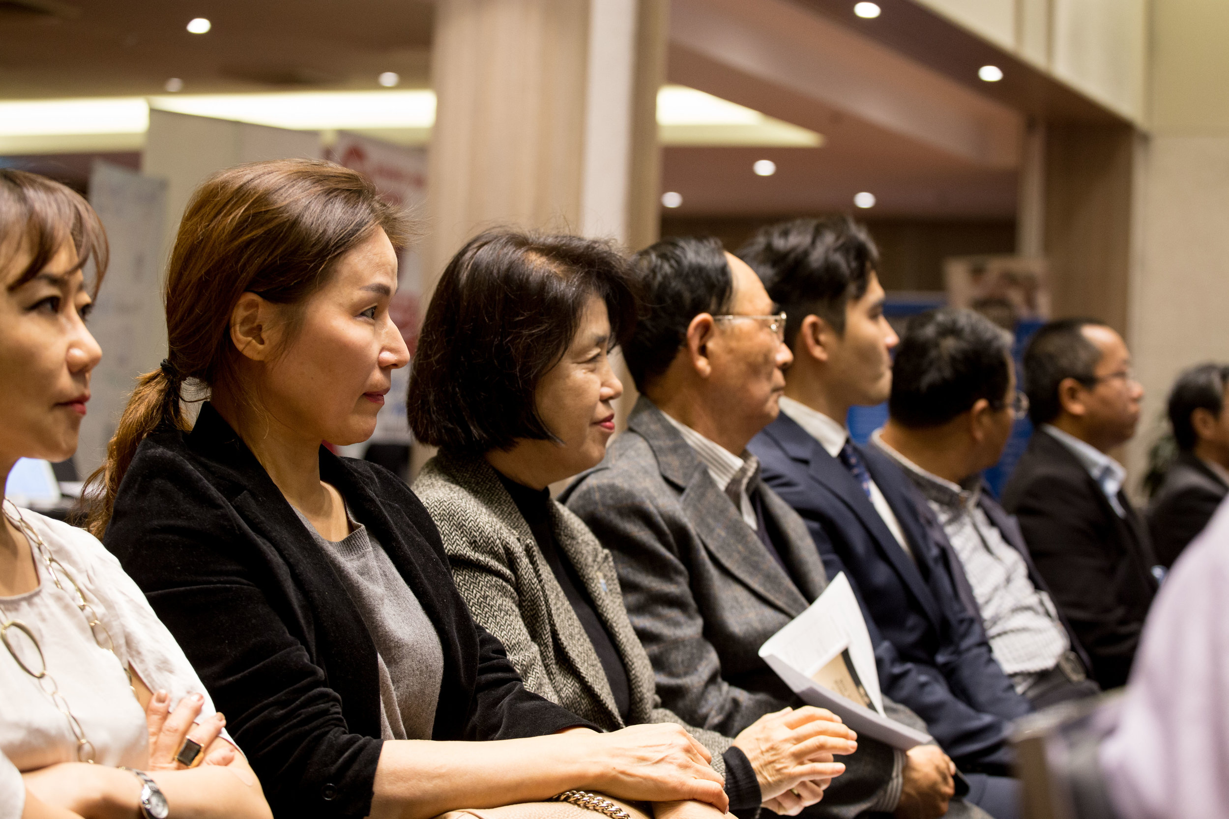 Small business owners listen tips given by industry experts