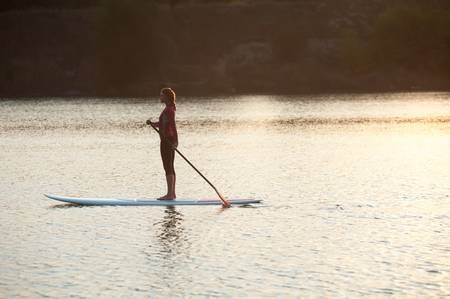 55413418-sup-stand-up-paddle-board-woman-paddleboarding.jpg