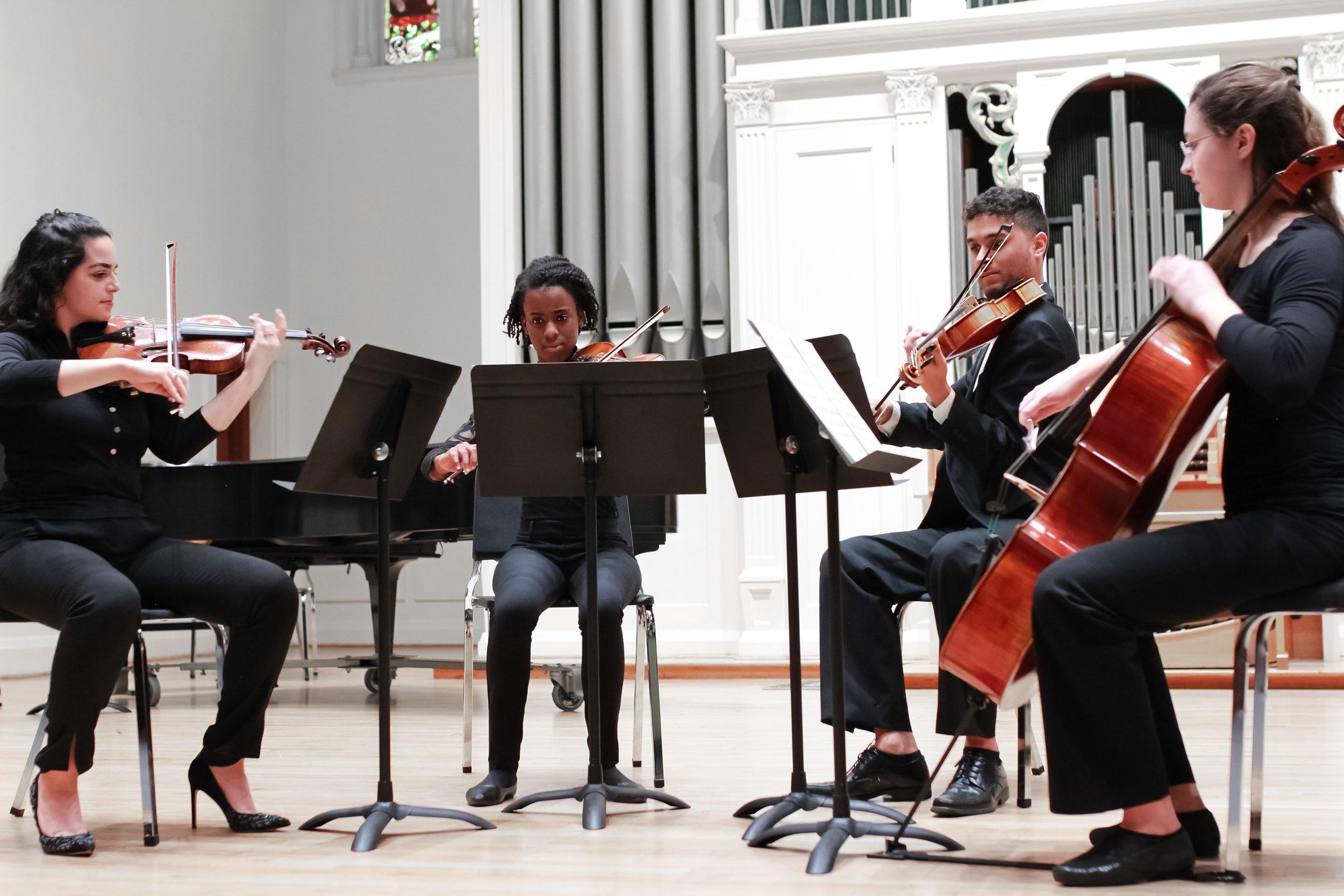 Gabriella Martinez (violin 1), Jaida Hawkins (violin 2), Kristian Gonzalez (viola), Megan Savage (cello)