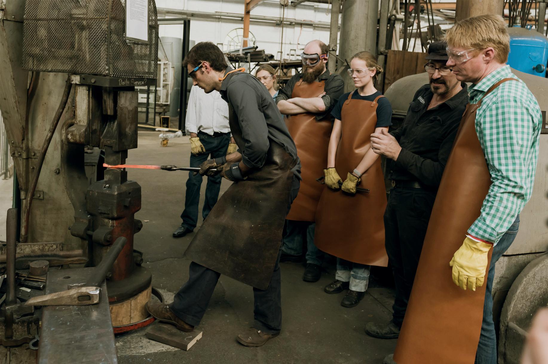 Matt demonstrating forging on a power hammer at Eveleigh Works, Redfern, Sydney