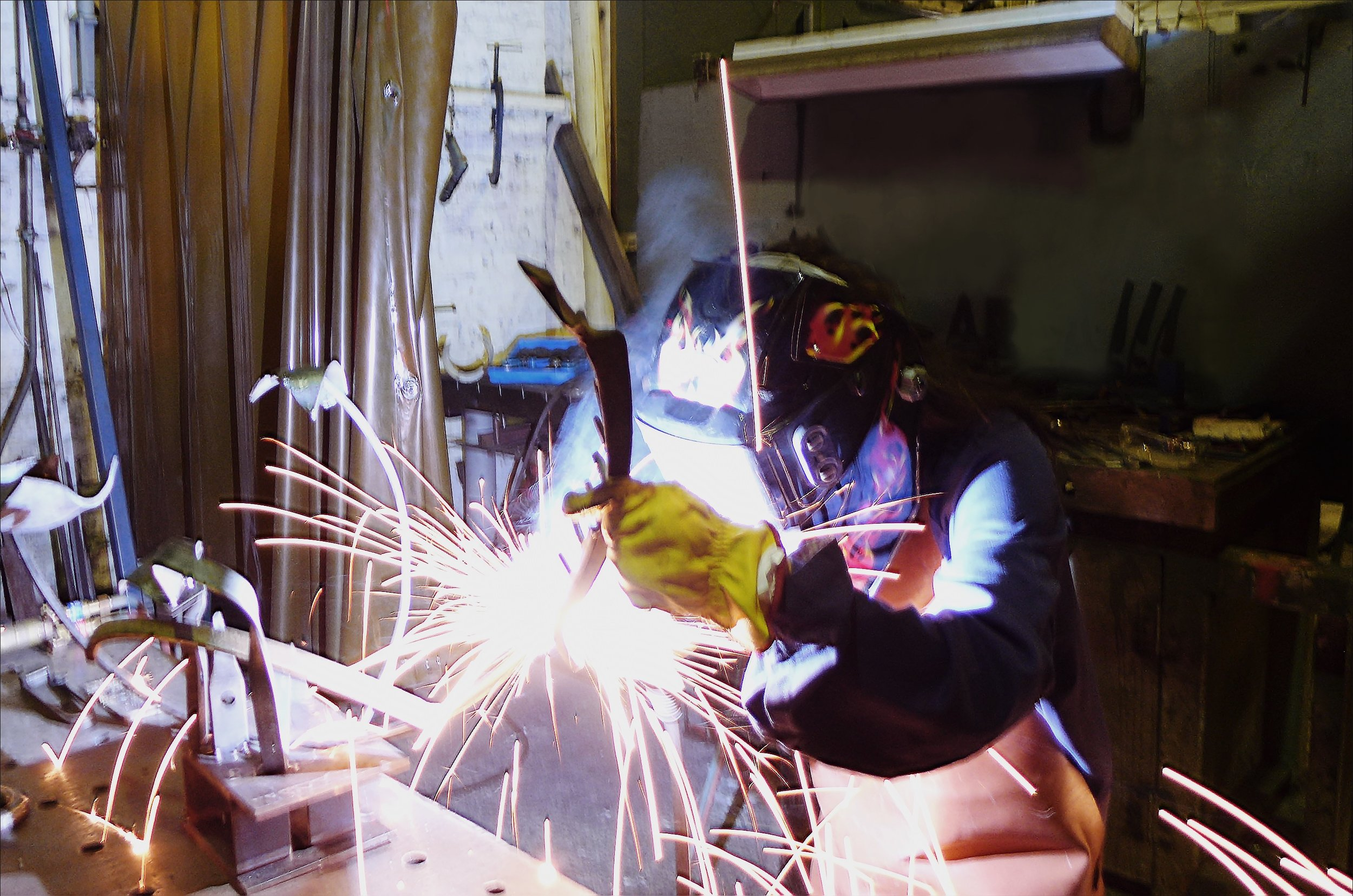 Welding a steel sculpture at the Metalwork for Sculpture course in Redfern