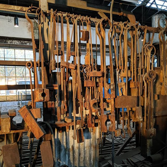 A little ray of sunshine... At just the right time of year, for just a few minutes each day, the longer wavelengths beat in sideways to splash around this rich orange.  These are just a fraction of the blacksmiths tools that were on display in bay 2 north here at Eveleigh.