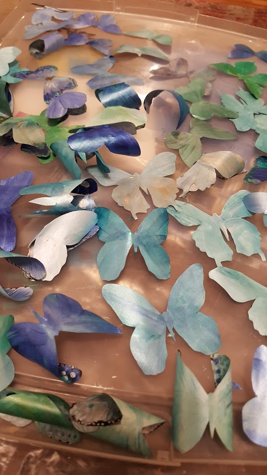AFTER EACH BUTTERFLY WAS CUT OUT - IT WOULD BE HAND COLORED ON IT'S BACK WITH CUSTOM MIXED IRIDESCENT SHIMMER PAINT
