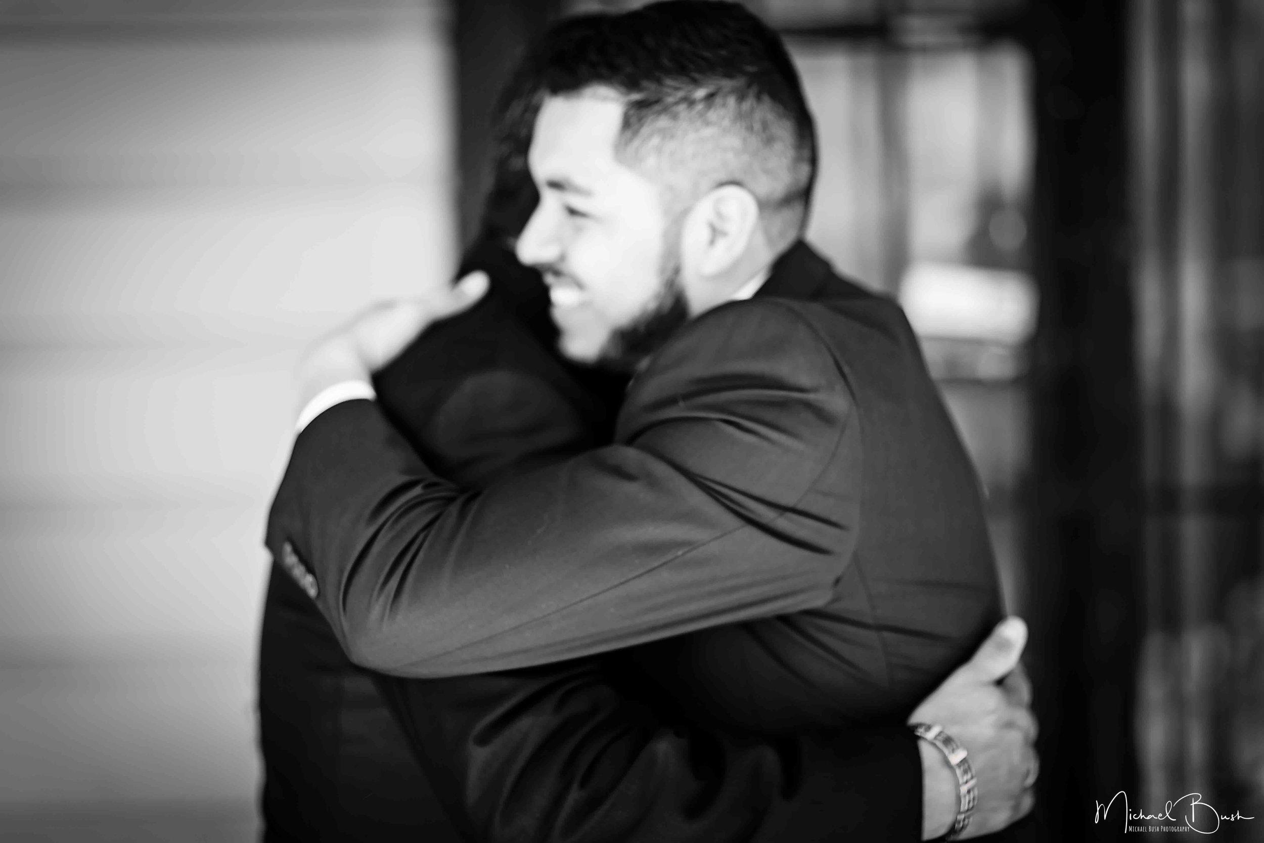 Wedding-Details-Groom-Fort Worth-b&w-Getting Ready-bestman-love-hugs.jpg