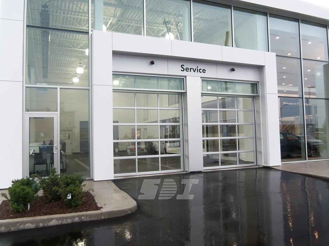Springless Sectional Door - Car Dealership