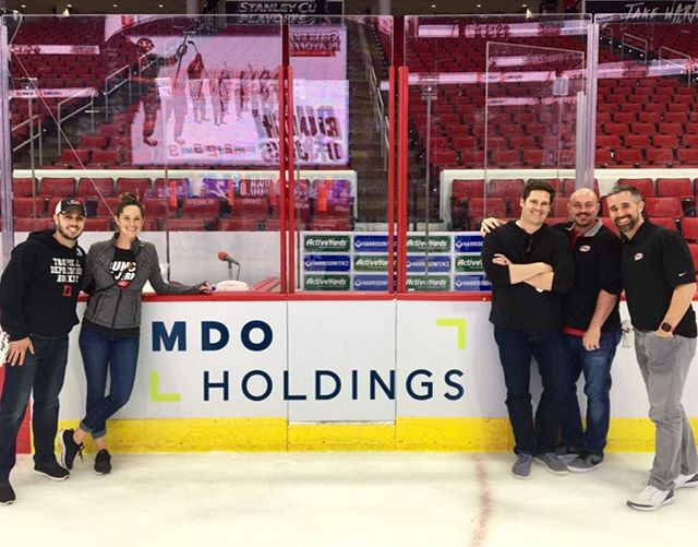 Playoff @nhlcanes is unreal and the energy is infectious. Working for a company that also values that is amazing. I have designed many things shown in @pncarena but putting our logo on a dasher is now one of my favorites #bunchofjerks #mdoholdings #o2fitness #midtownyoga #happyandhale #parlorblowdrybar