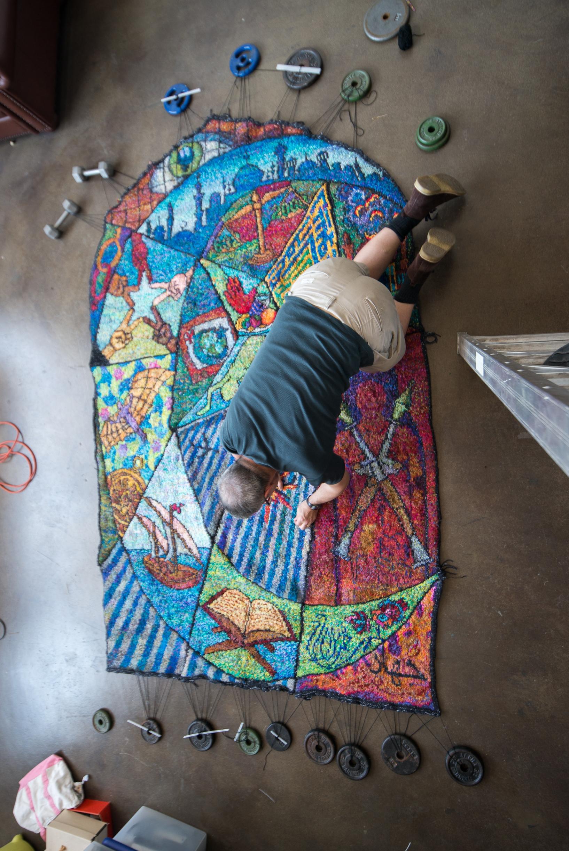 Islam_Tapestry-6573 sewing in ends, kneeling.jpg