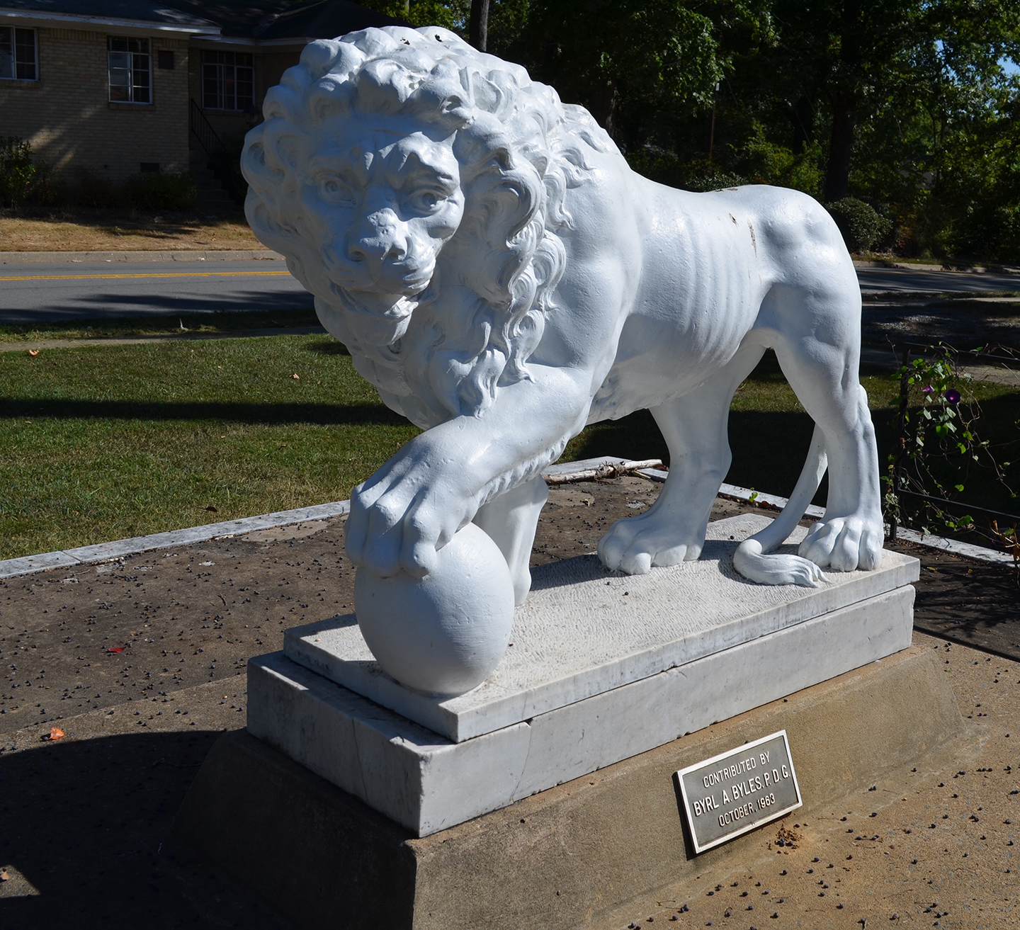 Marble statue of a lion that sits on the front lawn at WSB.