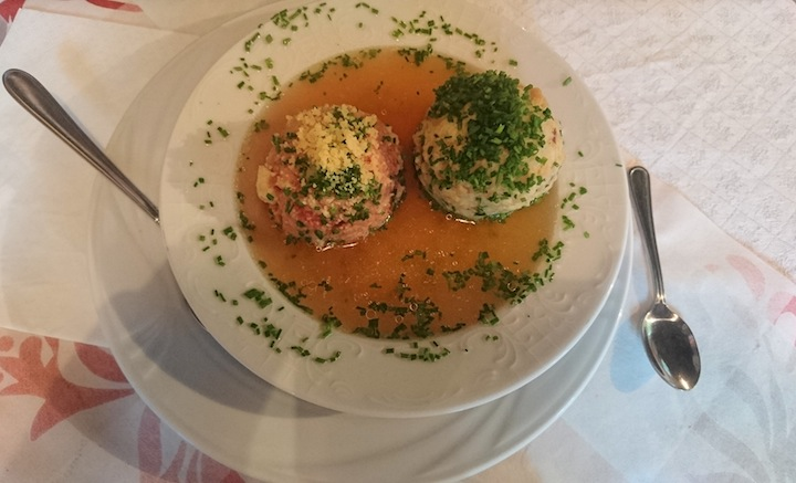 "Knödelsuppe - The most delicious meal here. One of the ""knödel"" was filled with beets which is why the broth is red."
