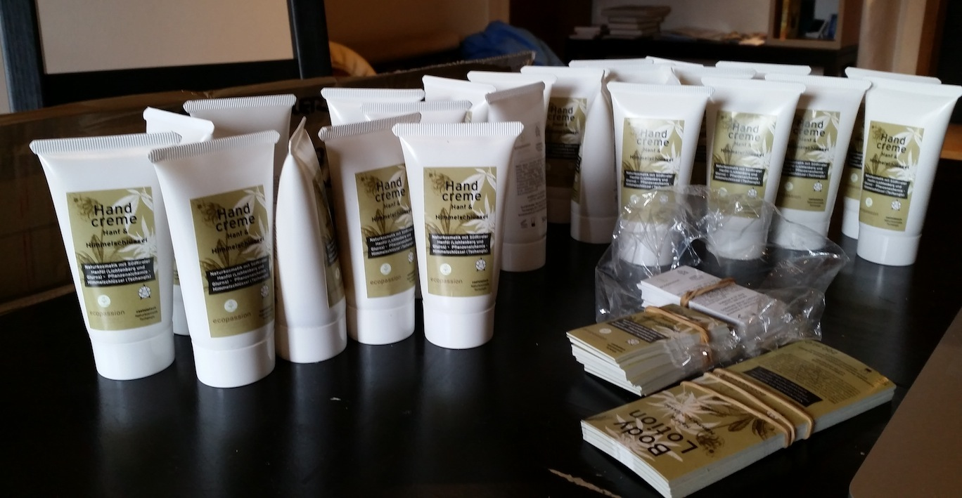 Putting labels on hemp lotion bottles to be sold at local markets.
